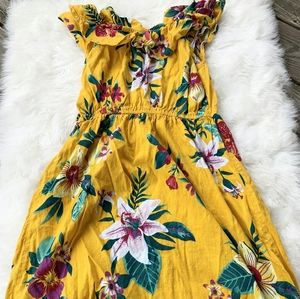 Yellow girl dress with tropical flowers